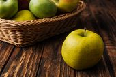 Golden Delicious Apple With Fruit Wicker Basket At Background poster