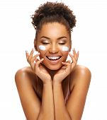 Happy Young Girl With Moisturizing Cream On Her Face. Photo Of Smiling African American Girl Isolate poster