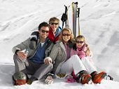 stock photo of ski boots  - Young Family On Ski Vacation - JPG