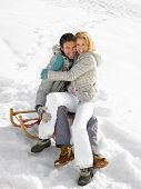 Young Couple On A Sled
