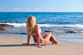 Young Attractive Woman Relaxing On The Beach.