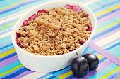 delicious plums baked with oats and cinnamon - sweet food shallow DOFF/