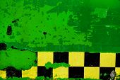 Green Peeling Paint With Checkered Tape Background