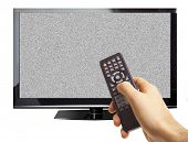 Male hand pointing remote control through TV screen with white noise isolated on white