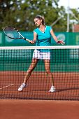 Beautiful Woman Playing Tennis