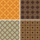 Collection of four decorative symmetric seamless patterns
