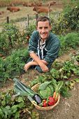 Portrait of smiling farmer in vegetable garden