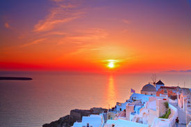 stock photo of greek-island  - Sunset in Oia village on Santorini island Greece - JPG