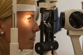 picture of slit  - Patient or customer at slit lamp at optometrist or optician - JPG