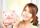 picture of lovely girl with big piggy bank