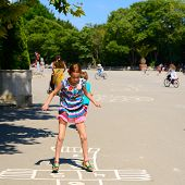 hopscotch, girl jumps in summer park outdoor