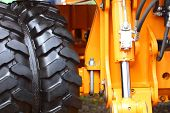 stock photo of dozer  - Detailed view of heavy vehicle big wheel of the building dozer or other construction machinery - JPG
