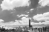 Taipei cityscape with dramatic clouds at sky, infrared photography in black and white.