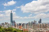 Cityscape of Taipei with skyscraper under dramatic clouds at blue sky in Taiwan, Asia.
