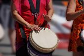 picture of penticton  - Close up of drumming by woman in bright clothes Penticton British Columbia Canada - JPG