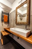 pic of wash-basin  - Wash basin and elegant mirror in a bathroom - JPG
