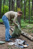 Girl helping clean up the forest in Elk Island National Park.