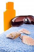 Towel, Shells, Sunglasses And Lotion poster