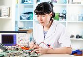 woman solder microchip