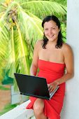 Smiling Beautiful Young Woman With Laptop