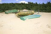 Three dingies on sand dunes