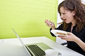 Close up of woman eating at her desk