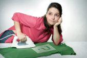 Woman bored ironing