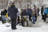 IRKUTSK, RUSSIA - JAN 19: People take water in the Holy well spring on Epiphany-day in January 19, 2