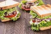 Fresh Made Tuna Sandwiches On Wood
