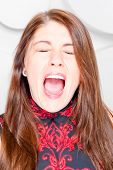 Beautiful Girl Loudly Shout Closed Eyes In Studio