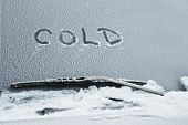 pic of wiper  - frozen windscreen and wipers of a car with hand written word COLD on it outdoor shot - JPG