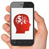 Advertising concept: Head With Finance Symbol on smartphone