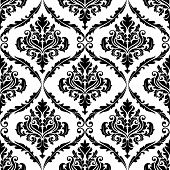 stock photo of adornment  - Black and white illustration of am ornate floral arabesque decorative seamless pattern with each motif in a foliate frame suitable for textiles and damask style fabric - JPG