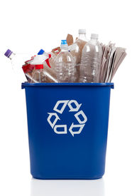 image of recycle bin  - An overflowing blue recycle bin full of plastic bottles newspapers and boxes with the recyle symbol on front - JPG