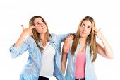 Girls Making Suicide Gesture Over White Background