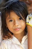 SIEM REAP, CAMBODIA, DECEMBER 04 : Cambodian little girl close portrait in a village near Siem Reap,