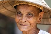 SIEM REAP, CAMBODIA, DECEMBER 04 : close portrait of an old Cambodian woman in a small and poor vill