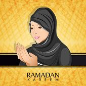 Religious Muslim girl in hijab, praying on abstract yellow background for holy month of Muslim commu