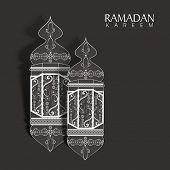 Arabic intricate lanterns on grey background for holy month of Muslim community Ramadan Kareem.