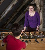 Boy And Girl Playing At Table Football