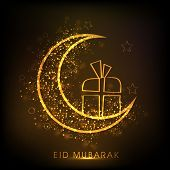 Golden crescent moon with gift box on shiny brown background for Eid Mubarak festival celebrations.