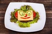 Face On Bread, Made From Cheese, Lettuce, Tomato, Cucumber And Pepper.