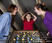Kids At Table Football