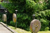 Three Pillars Ancient Millstones Along Hang Trees