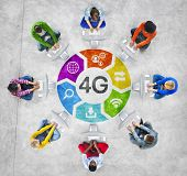 Diverse People in a Circle Using Computer with 4G Concept