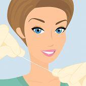 Friendly female dentist demonstrates floss
