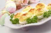 Deviled Eggs On Easter Plate With Decorations