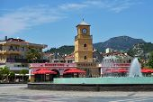 MARMARIS, TURKEY - MAY 14, 2014: Clock tower and fountains on the Youth square. The square is the place for open air concerts, shows and the place to celebrate the public holidays