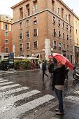 Tourist With Red Umbrella