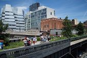 Tourists Stroll On The High Line In New York City